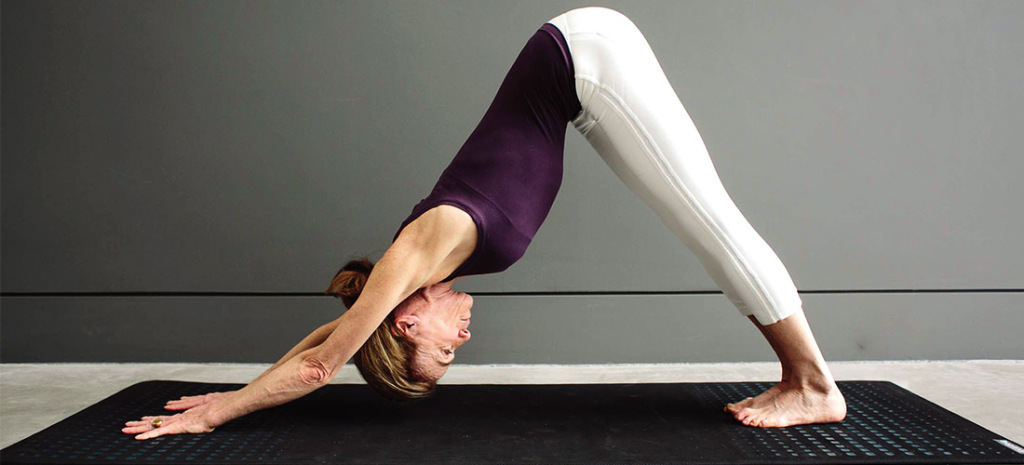 Get down on your fours and lift up your buttocks in a Downward dog pose to strengthen your liver. #Yoga