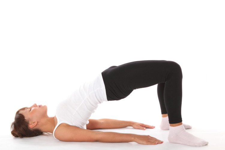 Lie down and lift up your buttocks in a Bridge pose to strengthen your liver. #Yoga