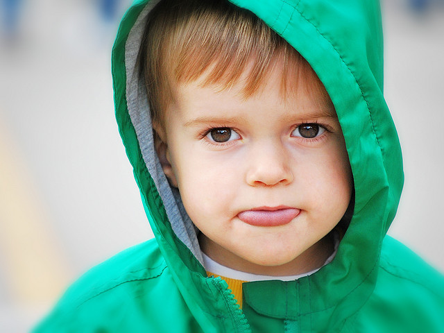 5 year old boy in hoodie showing tongue