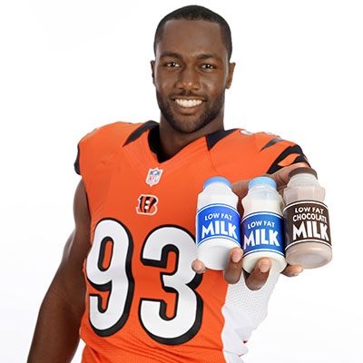 athlete holding low fat chocolate milk
