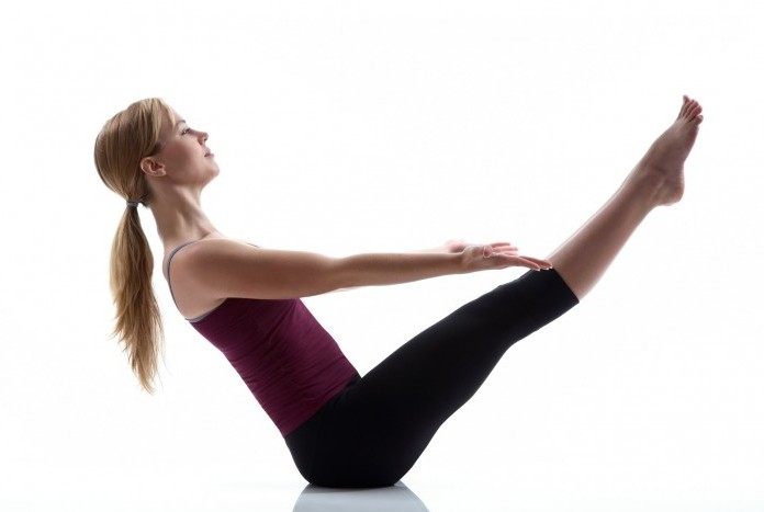 Lift up feet and tuck in your abdomen in a Bridge pose to strengthen your liver. #Yoga