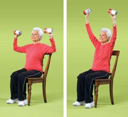 Elderly lady exercising with dumbbells