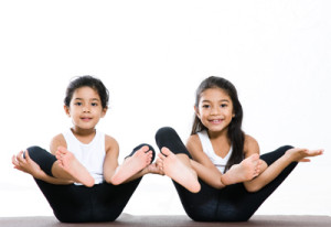 Two small girls doing Yoga