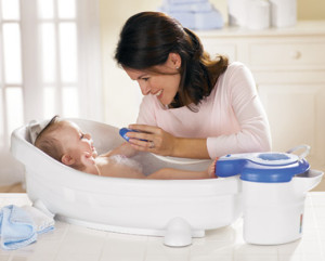 Mommy giving baby a bath