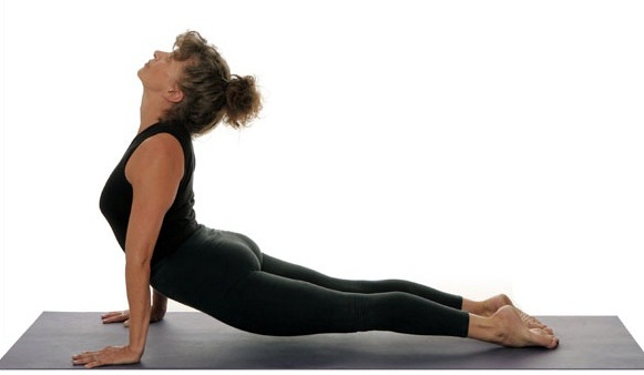 Lie down and lift up your torso in an Upward facing dog pose to strengthen your liver. #Yoga