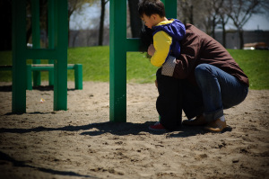 Child with parent in the park